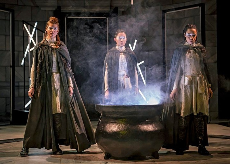 Image of the witches around a hazy cauldron in Short Shakes! Macbeth by William Shakespeare adapted and directed by Marti Lyons at Chicago Shakespeare Theatre