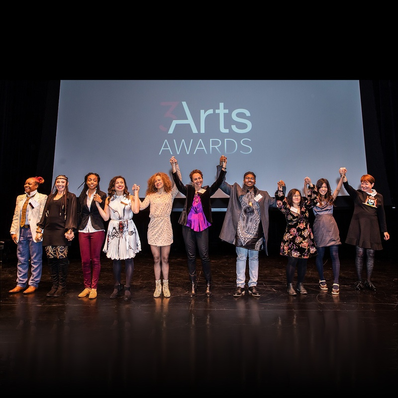 The 2018 3Arts Awardees holding hands on stage at the Museum of Contemporary Art