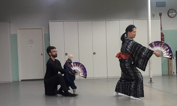 Japanese classical dancer rehearsing with puppet